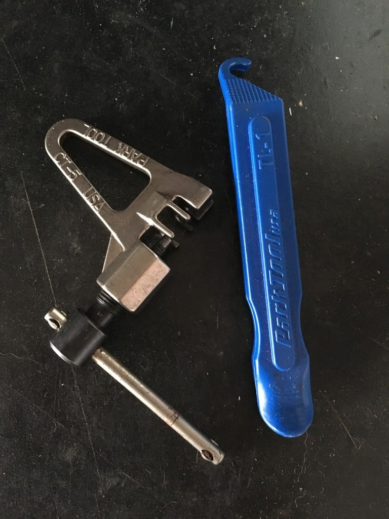 A chain tool and tire lever